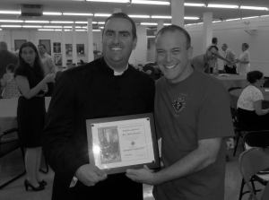 Fr. Robert Sinatra receives the Chaplain of the Year Award from Assumption Council #3397 Grand Knight Ray Iacovone.
