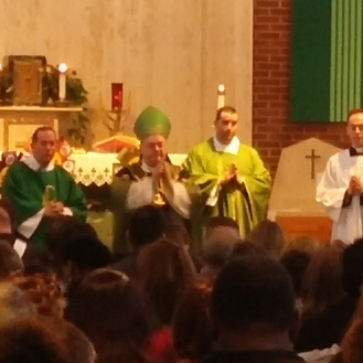 Deacon Kevin, Bishop Sullivan and Fr. Robert Sinatra await the offertory.