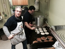 The cooks Michael Hensh and Neal Cullen kept the food coming all morning.