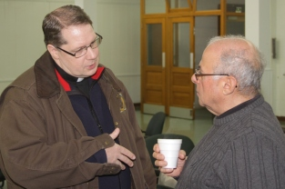 Fr. Matthew Weber chats with Bob Irerra.