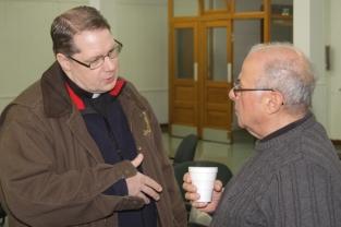 Fr. Matthew Weber chats with Bob Irerra.
