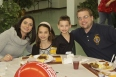 Our newest member, Doug Miedel, takes a break to eat with his lovely family.