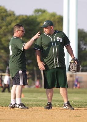 As the manager of St. Bridget's softball team, Jim Cosgrove gives some advice to our first baseman and Field Agent George Hayes.