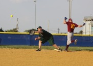 George Hayes stretches for a ball thrown just a hair too late to get the runner out.