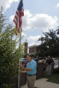 Grand Knight Ray Iacovone raises the flag during the ceremony.