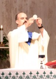 Fr. Goyette presents the Eucharist.