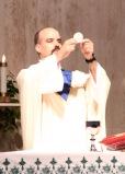 Fr. Goyette presents the Eucharist.