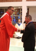 District Deputy Joe Williams Installs Grand Knight Jim Cosgrove.