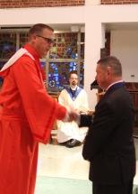 District Deputy Joe Williams Installs Grand Knight Jim Cosgrove.