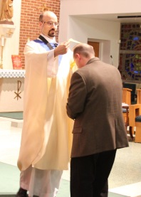 Deacon Kevin Heil is installed as Advocate by Fr. Goyette.