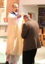 Deacon Kevin Heil is installed as Advocate by Fr. Goyette.
